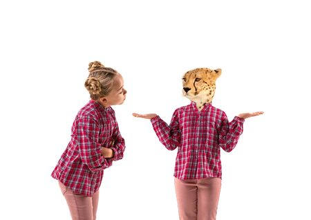 Young handsome girl arguing with herself as a leopard on white studio background. Concept of human emotions, expression, mental issues, internal conflict, split personality. Agressive talking.