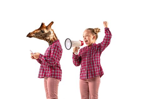 Young handsome girl arguing with herself as a giraffe on white studio background. Concept of human emotions, expression, mental issues, internal conflict, split personality. Agressive talking. Reklamní fotografie
