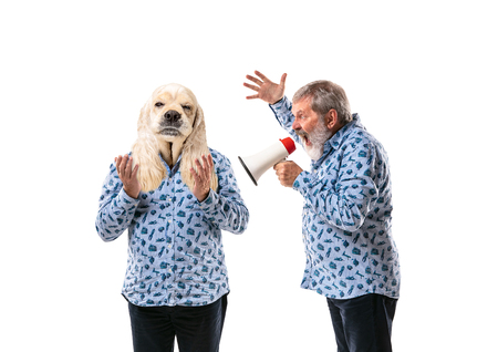Portrait of senior man arguing with himself as a dog on white studio background. Concept of human emotions, expression, mental issues, internal conflict, split personality. Copyspace. Scream. Reklamní fotografie
