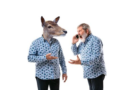 Portrait of senior man arguing with himself as a deer on white studio background. Concept of human emotions, expression, mental issues, internal conflict, split personality. Copyspace. Scream.
