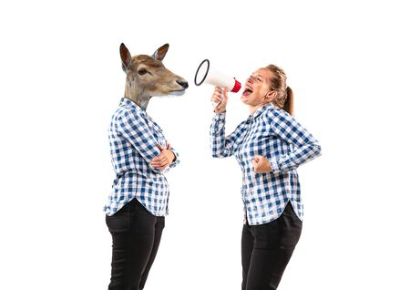 Portrait of young woman arguing with herself as a deer on white studio background. Concept of human emotions, expression, mental issues, internal conflict, split personality. Negative space. Reklamní fotografie