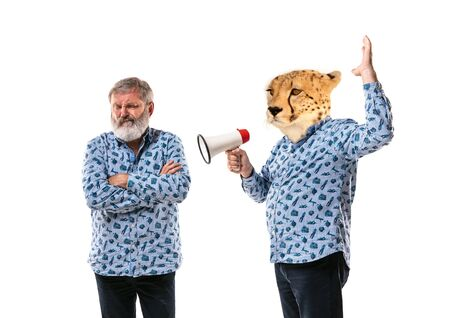 Portrait of senior man arguing with himself as a leopard on white studio background. Concept of human emotions, expression, mental issues, internal conflict, split personality. Copyspace. Scream.