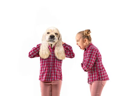 Young handsome girl arguing with herself as a dog on white studio background. Concept of human emotions, expression, mental issues, internal conflict, split personality. Agressive talking. Reklamní fotografie