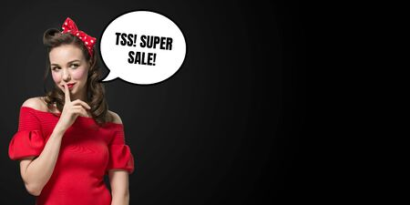Retro portrait of woman with speech bubble on black background. Copyspace for your advertising. Black friday, cyber monday, sales, money and cash, online purchases and payments. Keeping secret.