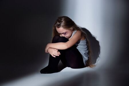 Sad and frightened little girl with bloodshot, bruised eyes sitting scared. Concept of child violence, domestic abuse. Sad, depressed being victim of parents and their agression. Childrens rights. 스톡 콘텐츠 - 133752493