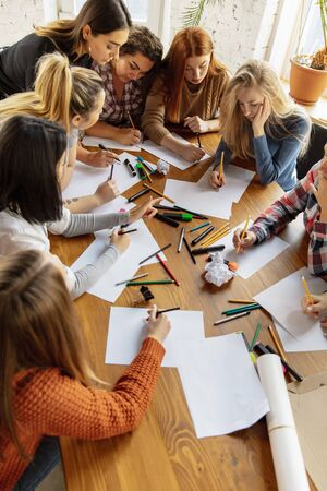 Top view of women preparing poster about womens rights and equality at the office. Caucasian businesswomen or office workers have meeting about problem in workplace, male pressure and harassment.