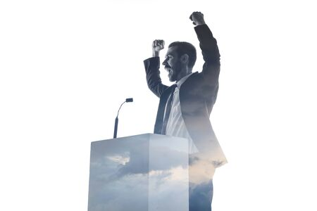 We won. Speaker, coach or chairman during politician speech isolated on white background. Double exposure - truth and lies. Business training, speaking, promises, economical and financial relations. Stock Photo