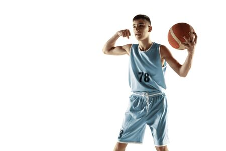 Full length portrait of young basketball player with a ball isolated on white studio background. Teenager celebrating winning. Concept of sport, movement, healthy lifestyle, ad, action, motion.
