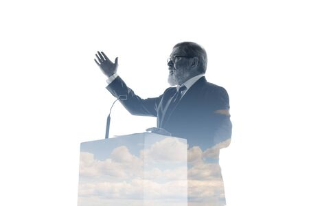 Promise. Speaker, coach or chairman during politician speech isolated on white background. Double exposure - truth and lies. Business training, speaking, promises, economical and financial relations. Stock fotó