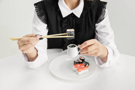We are what we eat. Close up of womans eating food made of plastic, eco concept. There is so much polymers then were just made of it. Environmental disaster, fashion, beauty. Loosing organic world.