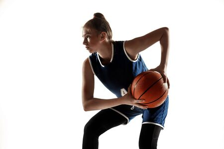 Young caucasian female basketball player of team in action, motion in run isolated on white background. Concept of sport, movement, energy and dynamic, healthy lifestyle. Training, practicing.