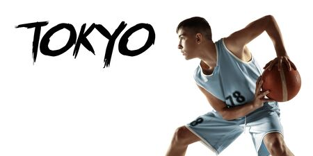 Portrait of young basketball player with ball isolated on white studio background. Teenager confident posing with ball. Concept of sport, movement, healthy lifestyle, ad, action, motion. Tokyo. Flyer. Stock Photo
