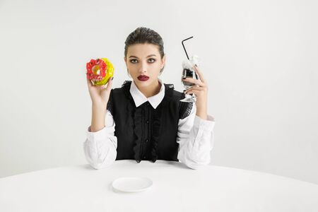 Woman with donut, cocktail made of plastic, eco concept.