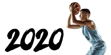 Meeting 2020 New Year. Young basketball player with a ball isolated on white studio background. Training, practicing in action, motion. Concept of sport, movement, healthy lifestyle, ad. Flyer for ad.