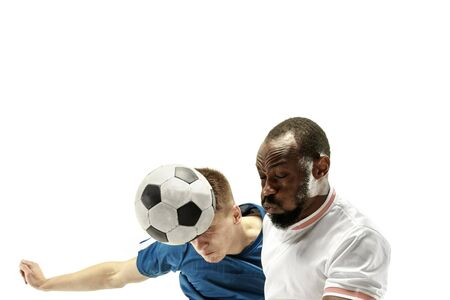 Close up of emotional men playing soccer hitting the ball with the head on isolated on white background. Football, sport, facial expression, human emotions concept. Copyspace. Fight for goal. Stok Fotoğraf