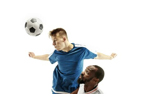 Close up of emotional men playing soccer hitting the ball with the head on isolated on white background. Football, sport, facial expression, human emotions concept. Copyspace. Fight for goal.