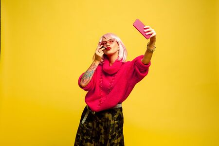 Its hard to be influencer. Cant make up without selfie or vlog. Caucasian womans portrait on yellow background. Beautiful blonde model. Concept of human emotions, facial expression, sales, ad.