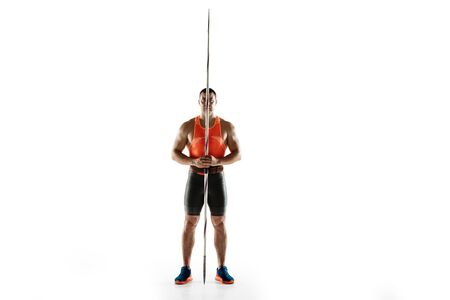 Male athlete practicing in throwing javelin isolated on white background. Professional sportsman, thrower posing confident. Concept of healthy lifestyle, movement, activity, competition. Copyspace.