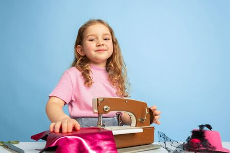 Big way. Little girl dreaming about profession of seamstress. Childhood, planning, education and dream concept. Wants to become successful employee in fashion and style industry, atelier, makes clothes. Stockfoto