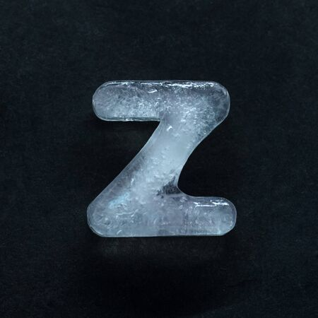 Melting speech. Alphabets shiny and well-structured letters made out of ice isolated on dark studio background. Collect for combine in words. Copyspace to insert your advertising.