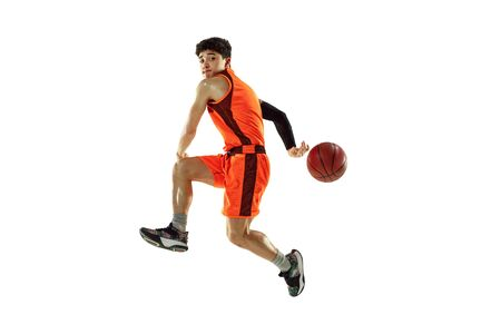 Young basketball player of team wearing sportwear training, practicing in action, motion in jump, flight isolated on white background. Concept of sport, movement, energy and dynamic, healthy lifestyle.