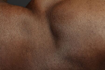 Detailed texture of human skin. Close up shot of young african-american male body. Skincare, bodycare, healthcare, hygiene and medicine concept. Looks beauty and well-kept. Dermatology.