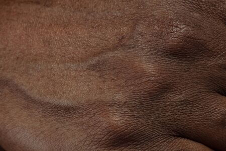 Fingers. Detailed texture of human skin. Close up shot of young african-american male body. Skincare, bodycare, healthcare, hygiene and medicine concept. Looks beauty and well-kept. Dermatology.