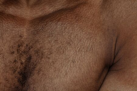 Chest. Detailed texture of human skin. Close up shot of young african-american male body. Skincare, bodycare, healthcare, hygiene and medicine concept. Looks beauty and well-kept. Dermatology.