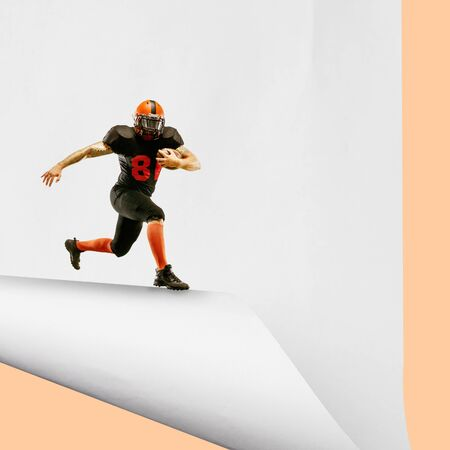 Imagine whos covering white sheet to get digital file icon. American football player, young man catching the edge of huge paper sheet. Digital world, funny imagination of the way the icons appearing.