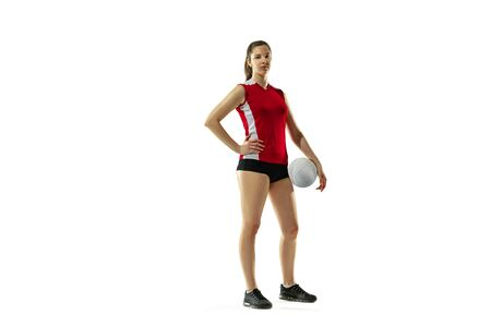 In jump and flight. Young female volleyball player isolated on white studio background. Woman in sportswear and sneakers training, playing. Concept of sport, healthy lifestyle, motion and movement. 免版税图像