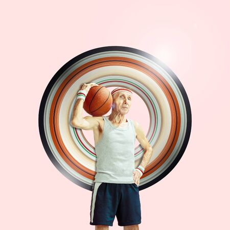 Concept of motion and action in sport. Full length portrait of a basketball player with a ball on background. Confident senior man posing. Motion, activity, movement, ad, wellness. Abstract design.