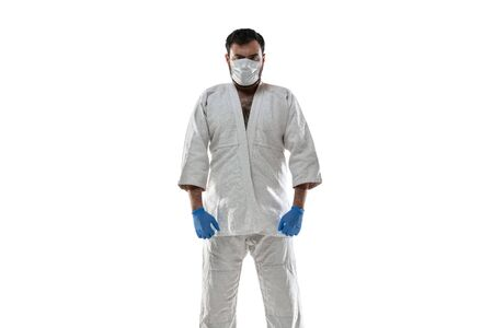 Punching virus. Martial arts fighter in protective mask and gloves. Prevention against pneumonia. Still active while quarantine. Chinese coronavirus treatment. Healthcare, medicine, sport concept.