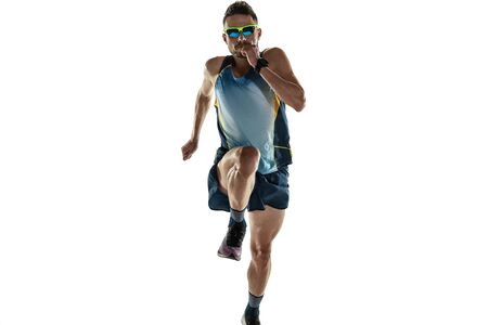 Triathlon male athlete running isolated on white studio background. Caucasian fit jogger, triathlete training wearing sports equipment. Concept of healthy lifestyle, sport, action, motion. In jump.