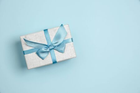 Gift, present box. Monochrome stylish and trendy composition in blue color on studio background. Top view, flat lay. Pure beauty of usual things around. Copyspace for ad. Holiday, celebration. Archivio Fotografico
