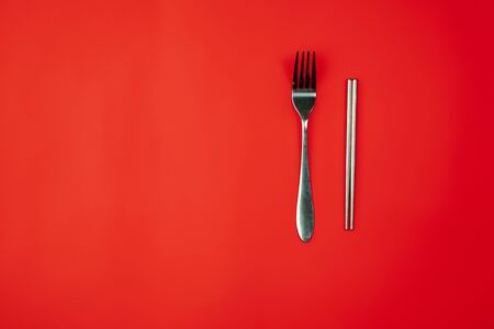 Fork and chopsticks. Eco-friendly life - organic made houseware in compare with polymers, plastics analogues. Home style, natural products for recycle and not harmful to the environment and health.