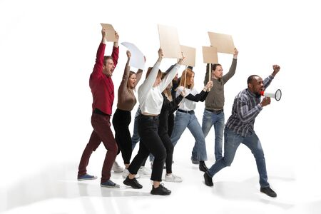 Emotional multicultural group of people screaming while holding blank placards on white background. Women and men shouting, calling. Activism, active citizenship, social life, protesting, human rights. Archivio Fotografico