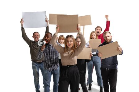 Emotional multicultural group of people screaming while holding blank placards on white background. Women and men shouting, calling. Activism, active citizenship, social life, protesting, human rights.