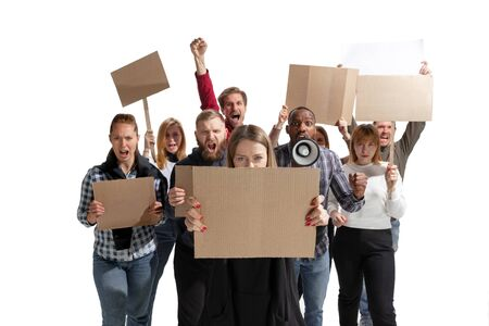 Emotional multicultural group of people screaming while holding blank placards on white background. Women and men shouting, calling. Activism, active citizenship, social life, protesting, human rights. Stock Photo