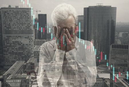 Stressed man holding head with hands on abstract city, megapolis background. Double exposure. Virus alert, coronavirus pandemic, COVID-19 epidemic. Lost job, fired, worried, unemployment, crisis.