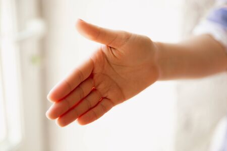 Close up view of caucasian female hand greeting somebody, copyspace. Communication, agreement, contract or meeting. Copyspace for advertising. Businesswoman or student. Stock Photo