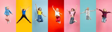 Emotional kids and teens jumping high, look happy, cheerful on multicolored background. Delighted, winning girls. Emotions, facial expression concept. Trendy colors. Creative collage made of 5 models.. Reklamní fotografie