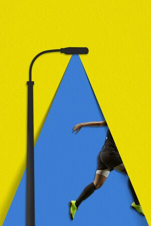 Running football player. The blue light of a paper lantern illuminates a walking person on yellow background. Dream, paperworld. Contemporary colorful and conceptual bright art collage with copyspace.
