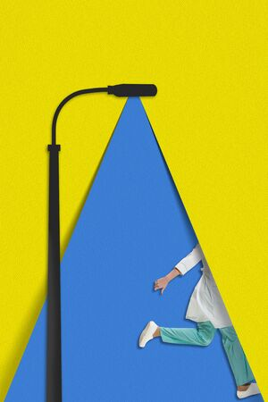 Running nurse, doctor. The blue light of a paper lantern illuminates a walking person on yellow background. Dream, paperworld. Contemporary colorful and conceptual bright art collage with copyspace. Zdjęcie Seryjne - 147818833