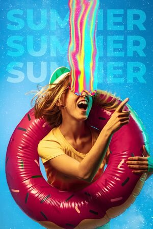 Woman with melting sunglasses and rubber swim donut on blue background. Copyspace. Modern designed poster. Contemporary artwork. Concept of summertime, vacation, resort, summer mood, beach season. Zdjęcie Seryjne - 147829796