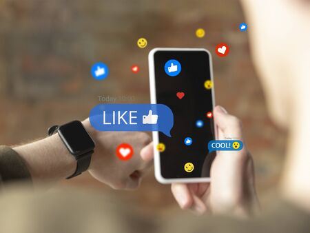 Male hands scrolling phone and sharing with social media, using gadget. Get comments, likes. Modern UI icons, communication, devices. Concept of modern technologies, networking, gadgets. Design. Imagens