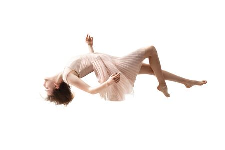 Mid-air beauty cought in moment. Full length shot of attractive young woman hovering in air and keeping eyes closed. Levitating in free falling, lack of gravity. Freedom, emotions, artwork concept.