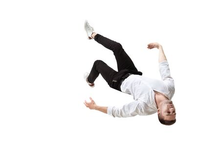 Mid-air beauty cought in moment. Full length shot of young man hovering in air and keeping eyes closed. Levitating in free falling, lack of gravity, flying. Freedom, emotions, artwork concept. Foto de archivo