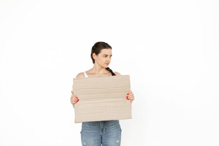Young woman protesting with blank board, sign isolated on white studio background. Activism, active social position, protest, actual problems. Meeting against human rights, abusing, freedom of choice. 版權商用圖片