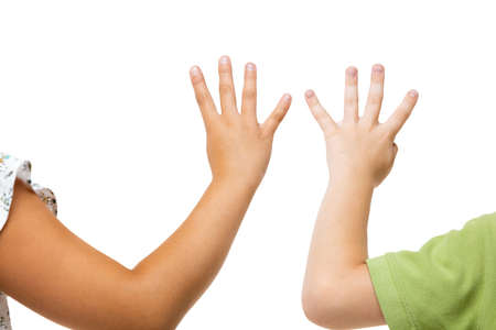 Showing four. Childrens hand, palm gesturing isolated on white studio background with copyspace for your advertising. Little girls hand with signs. Childhood, education, sales, ad, expression concept.