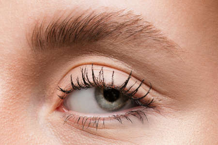 Tired. Close up of face of beautiful caucasian young woman, focus on eyes. Human emotions, facial expression, cosmetology, body and skin care concept. Well kept cheeks, narutal make up. Wellbeing. Banque d'images